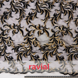 Tejido de tul bordado. En la imagen, combinado con piel de ángel (modelo NIDIA).